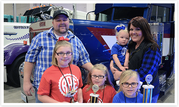 Photo of a Family attending the Annual Truck and Trailer Show